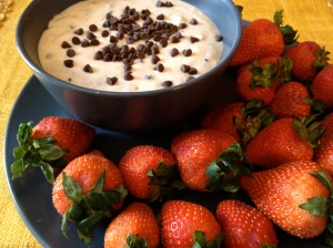 A photo of strawberries and a cannoli cream dip.